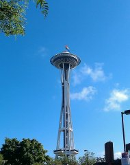 Rainbow flag flying on the Space Needle during Seattle Pride.