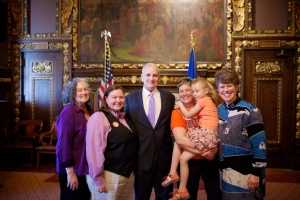 The author Kathleen Campisano with Gov. Mark Dayton and Task Force staff and family at the bill signing.