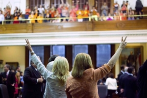 Sens. Wendy Davis, left, and Sylvia R. Garcia cast their votes against Senate Bill 5 amidst the cheers of the gallery. Photo Credit: AP/Daily Texan