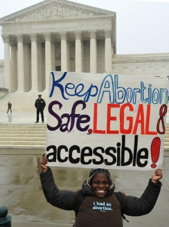 Protester Holding Sign Saying Keep Abortion Safe, Accessible and Legal
