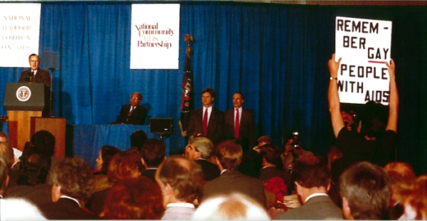 Task Force Executive Director Urvashi Vaid interrupts President Bush's first and only AIDS policy speech, at the 1990 National AIDS Community Partnership Meeting